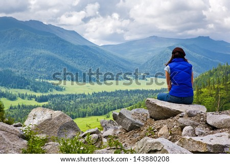 woman in mountains - stock photo
