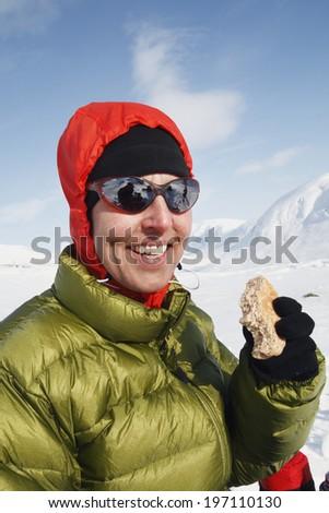 Woman in mountains having coffee break, Kebnekaise, Lapland, Sweden - stock photo
