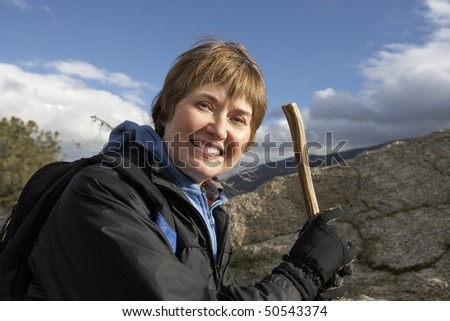 Woman in mountains, (portrait)