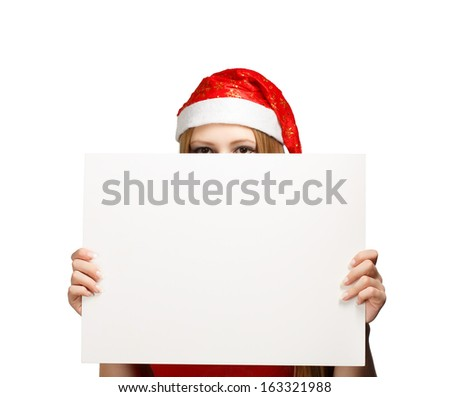 Woman in new year or christmas hat hiding behind the advertisement isolated on white background