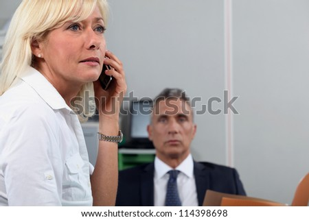 Woman in office with colleague - stock photo