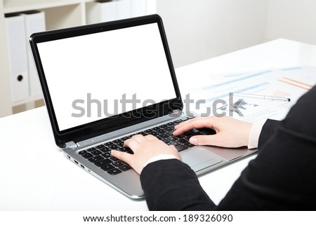 woman in office with laptop and white desk - stock photo