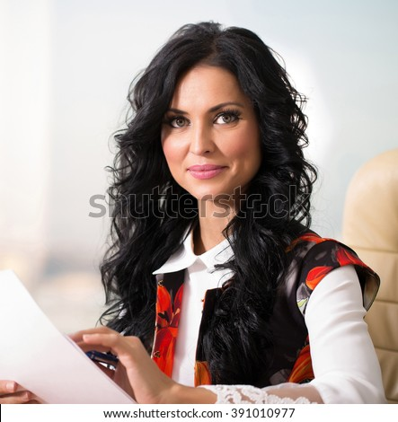woman in office working with papers