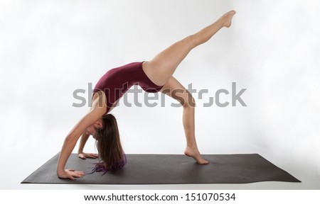 Woman in One Legged Wheel Yoga Pose - stock photo
