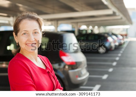 woman in  parking lot  at sunny day.