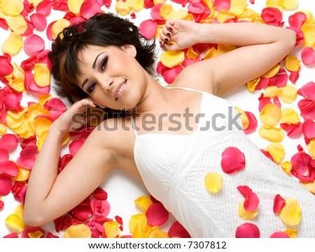 Woman in Petals - stock photo