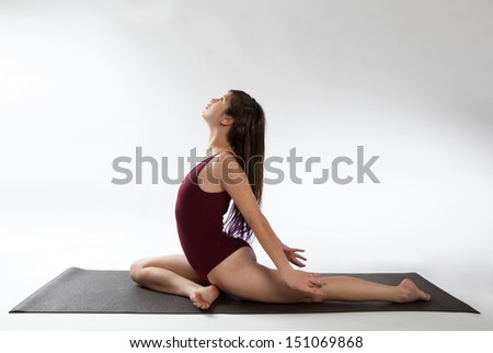 Woman in Pigeon Pose Variation - stock photo