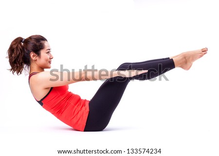 woman in pilates action ( isolated ) - stock photo