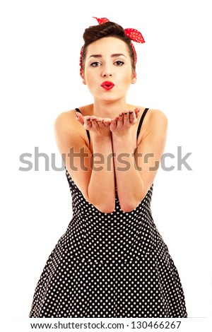 Woman in Pin-up style on white background kissing