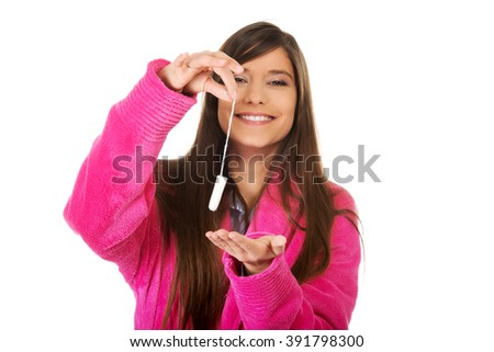 Woman in pink bathrobe with tampon. - stock photo
