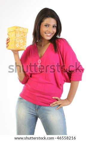 Woman in pink dress holding gift box - stock photo