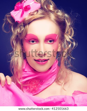 Woman in pink. Portrait of young lady in creative image.