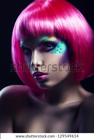 woman in pink wig in dark - stock photo