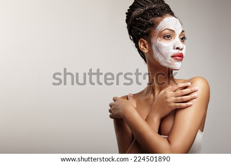 woman in process of a facial treatment - stock photo