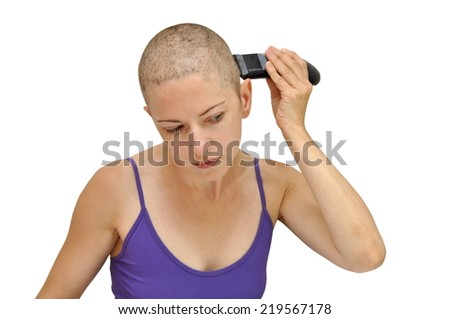 Woman in purple bodice shaving herself bald using left hand, isolated on white.
