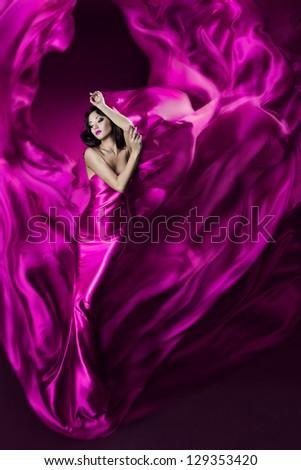 Woman in Purple Silk Waving Dress, Girl Artist Dancing in Flowing Cloth on wind - stock photo