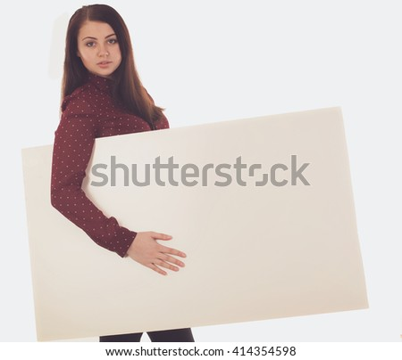 Woman in red blouse is holding a blank canvas