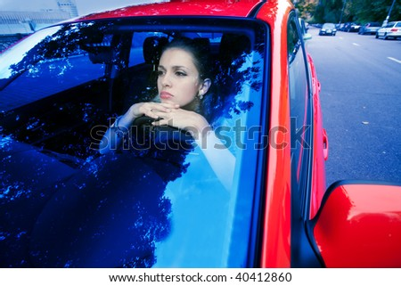 woman in red car dreams of future