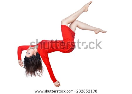Woman in red dress falls on a white background. - stock photo