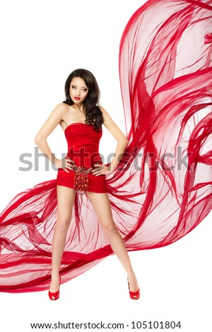 Woman in red dress. Hands on hips. Chiffon flutter on a wind flow over white background - stock photo