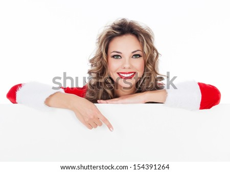 Woman in red dress holding a blank billboard, white background, copyspace  - stock photo