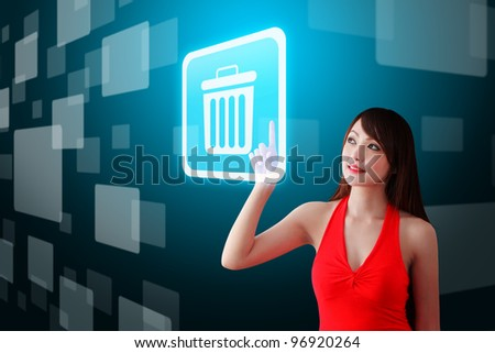 Woman in red dress touch the Bin icon - stock photo