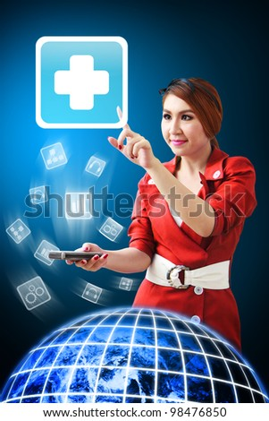 Woman in red dress touch the First Aid icon from mobile phone : Elements of this image furnished by NASA - stock photo