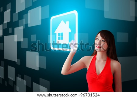 woman in red dress touch the house icon - stock photo