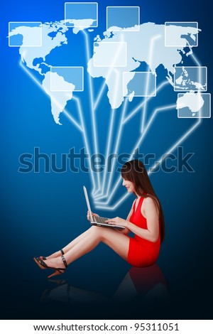 Woman in red dress using notebook computer and connect to world map