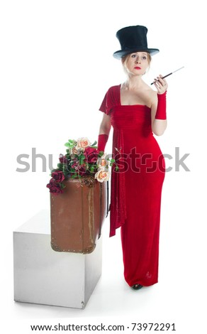 Woman in red dress with a cigarette in the mouthpiece