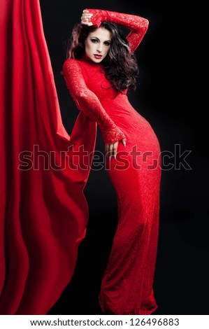 Woman in red dress with curly and  bright make up. Valentines day,