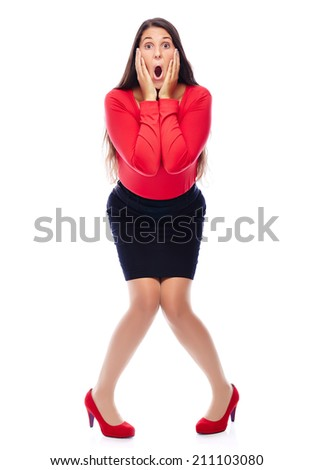 Woman in red is shocked isolated on white - stock photo