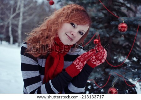 Woman in red mittens