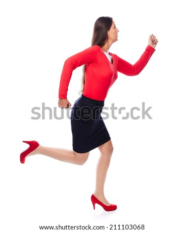Woman in red running sideways, is short on time isolated on White - stock photo