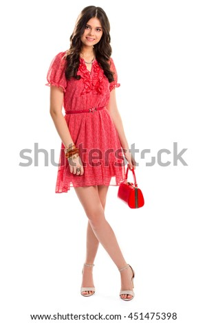 Woman in red summer dress. Young girl is smiling. Attractive fashion model. Stylish casual look. - stock photo