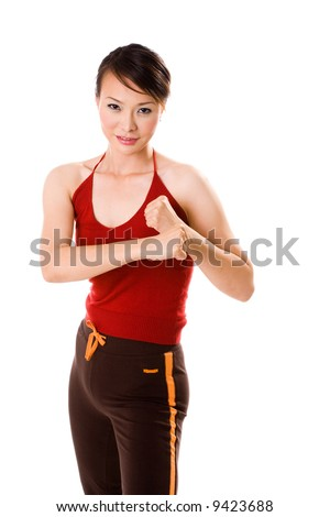 woman in red tank top in a bare fist boxing pose - stock photo