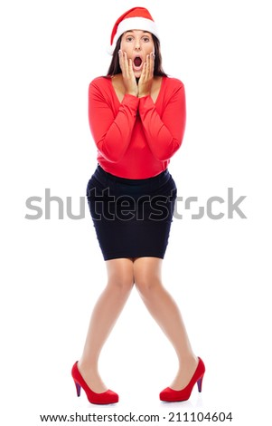 Woman in red wearing santa hat is shocked isolated on white - stock photo