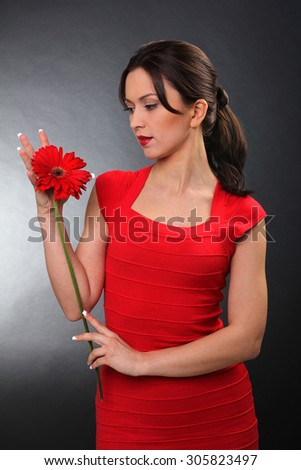 woman in red with red gerbera