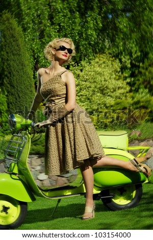 Woman in retro dress with a scooter - stock photo