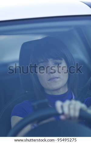 Woman in risk driving holding and talking at her cellphone - stock photo