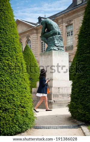 woman in Rodin museum in Paris  - stock photo