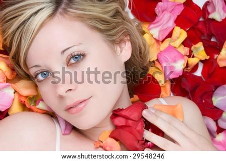 Woman in Rose Petals - stock photo