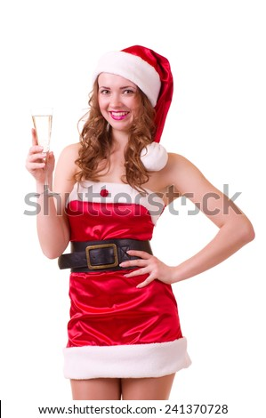 woman in Santa Claus clothes with champagne glass - stock photo