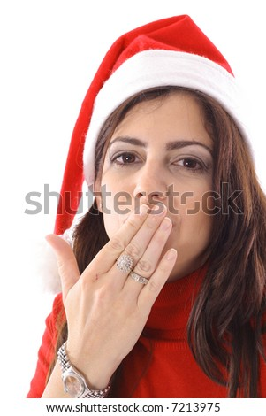 Woman in Santa hat blowing a kiss - stock photo