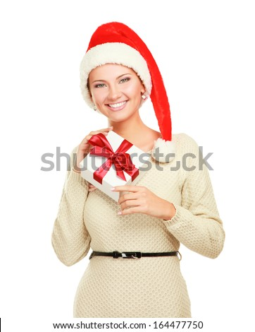 Woman in Santa hat holding gift box, isolated on white background - stock photo