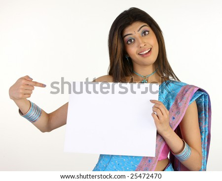 Woman in sari pointing white placard
