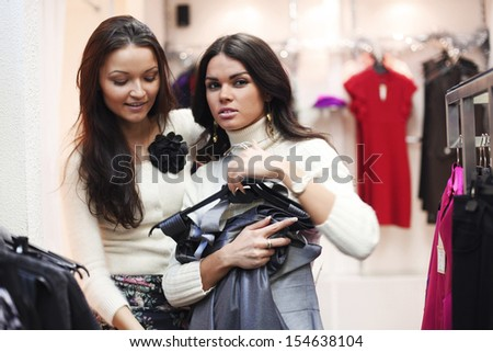 woman in shop look at clothes