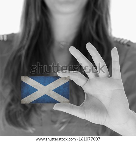 Woman in showing a business card, Scotland