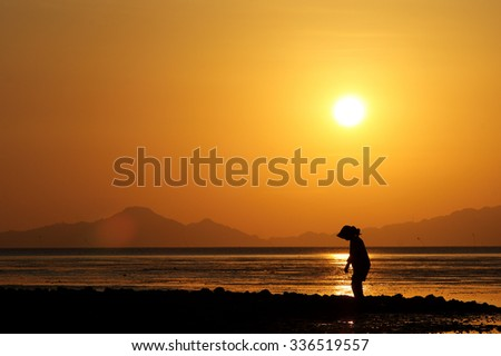 Woman In Silhouette During Sunset By The Beach In Northern Malaysia