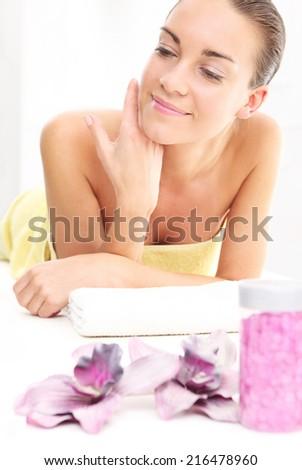 Woman in spa salon .Attractive brunette woman in spa salon. - stock photo